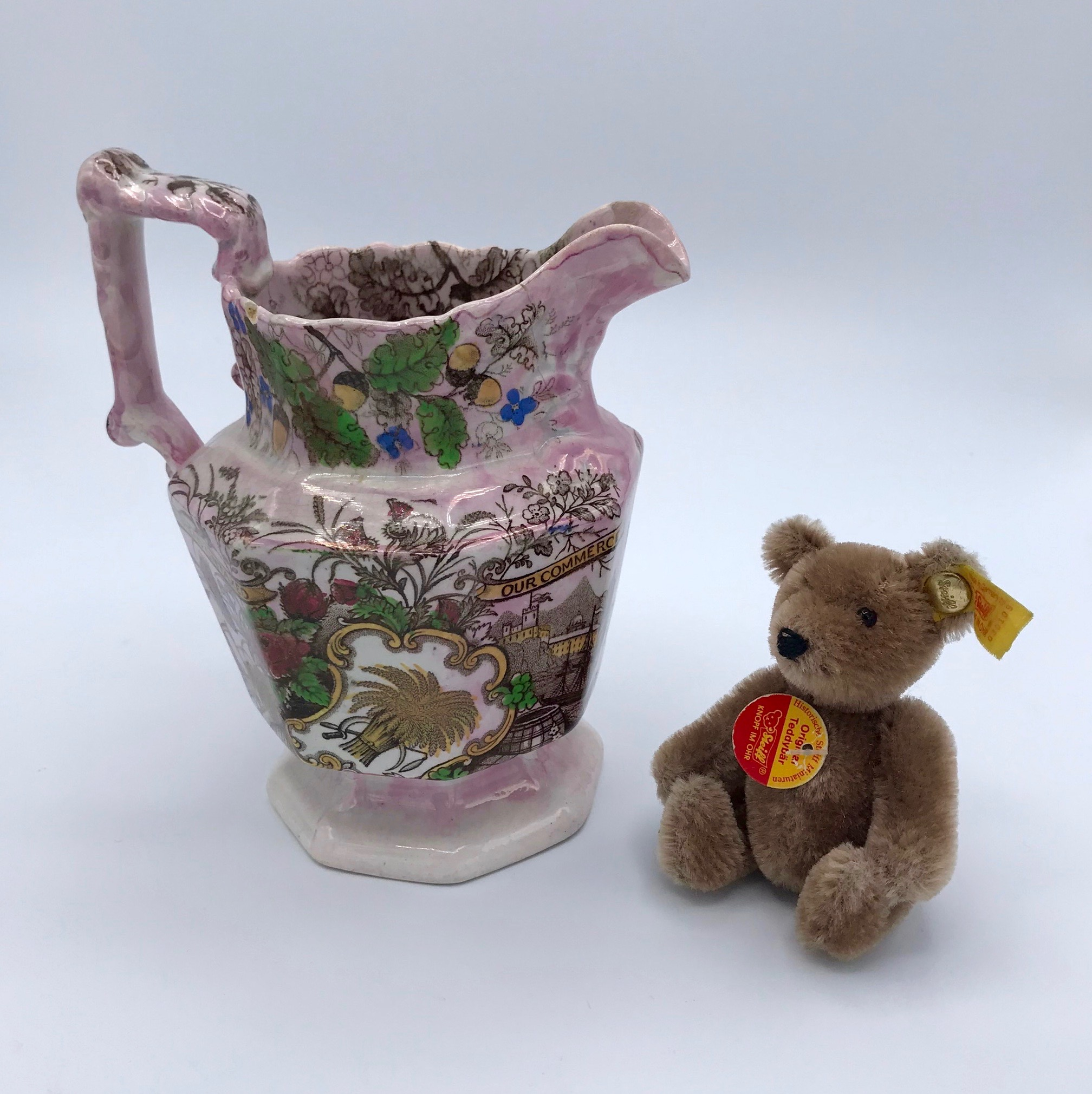 """Our Bread Untaxed"" Pink Lustre Jug"